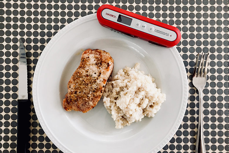 The Maverick PT-60 Pocket Knife Thermocouple Digital Meat Thermometer resting on a plate of food, shot from above