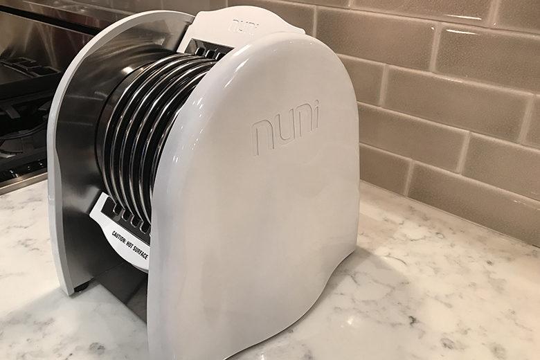 The Nuni Tortilla Toaster on a marble countertop