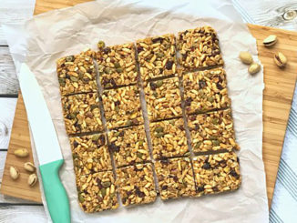 Cranberry Pistachio Granola Bar Squares shot from above and cut into 16 equal pieces.