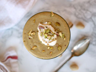 Homemade pistachio pudding in a glass dish shot from overhead