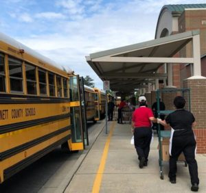 Loading school buses to deliver meals to children