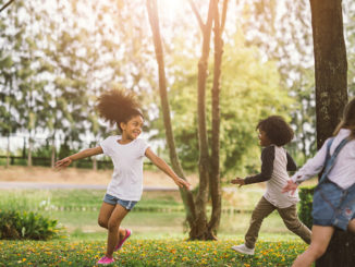 African american little girls playing outdoors