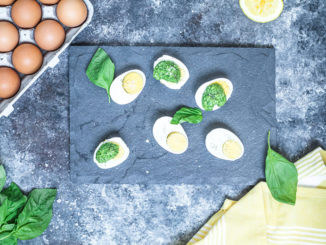 Parmesan Pesto Over Eggs on a slate serving board
