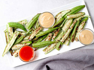Spicy Roasted Okra with Peanut Sauce on a rectangular white place