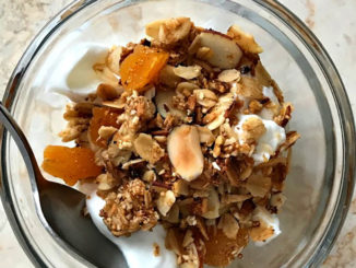 Springtime Slow Cooker Granola, with yogurt, in a bowl with spoon