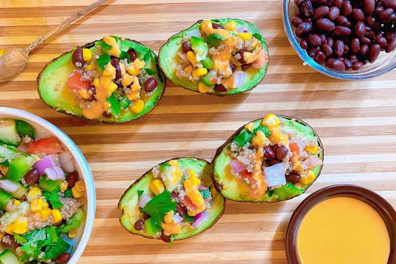 Quinoa Salad Stuffed Avocados with Hummus Dressing - Food & Nutrition Magazine - Stone Soup