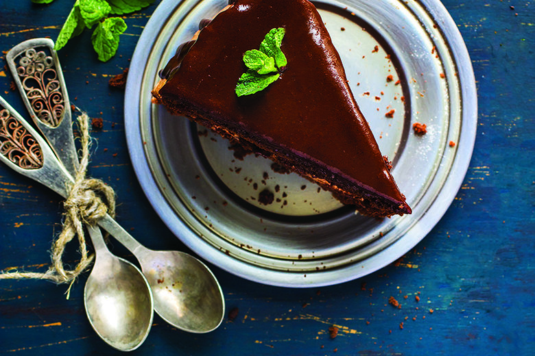 Piece of chocolate cake with mint leaves