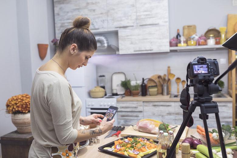 Woman enjoying cooking and vlogging