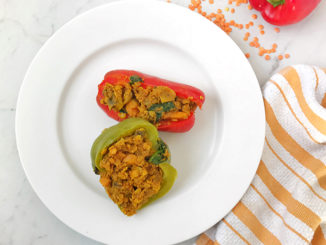 Curried Lentil Stuffed Peppers on a white plate
