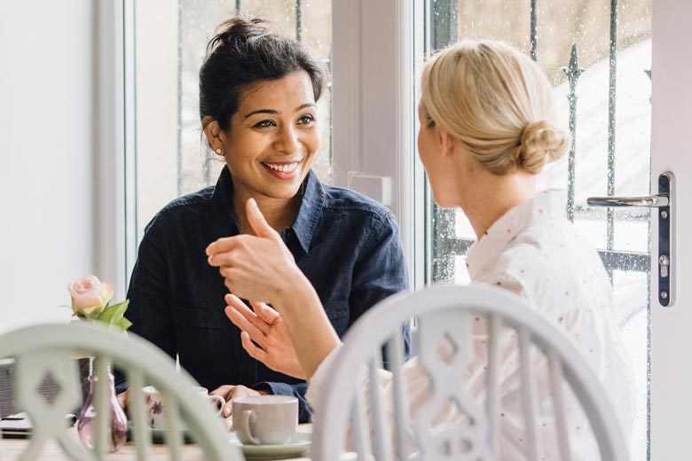 Two woman having coffee and a conversation