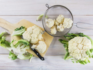 Fresh cauliflower on kitchen table