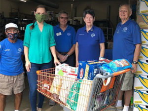 Gisela Bouvier delivering items to food bank