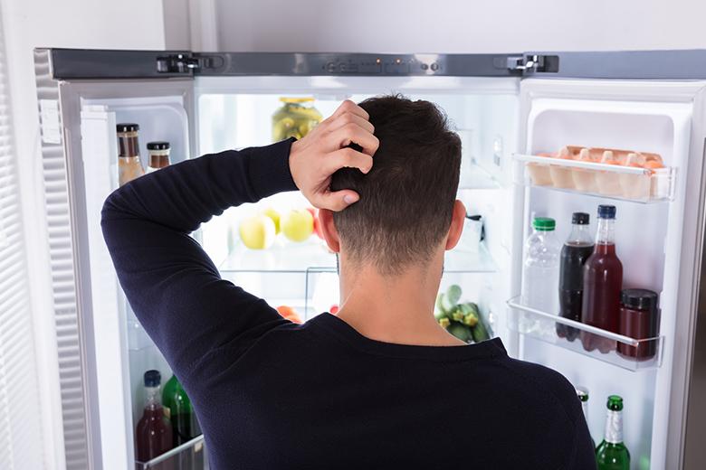 Man looking in Refrigerator