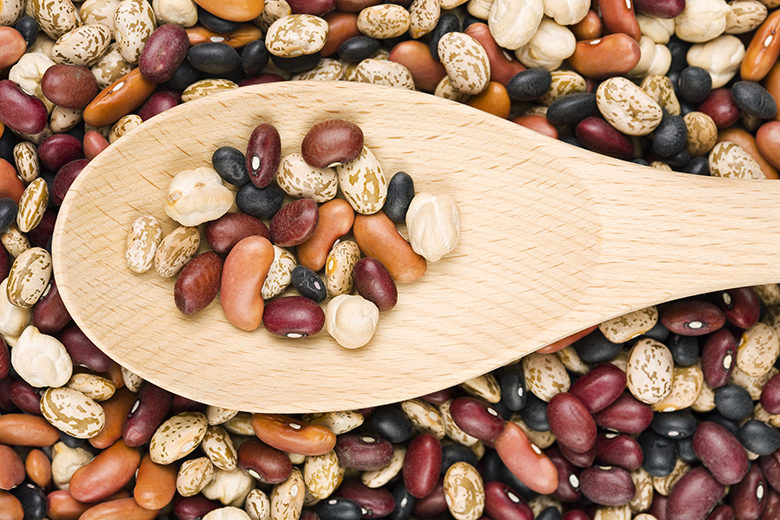 A Variety Of Dried Beans And Wooden Spoon
