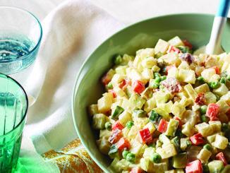 Creamy potato salad in green bowl