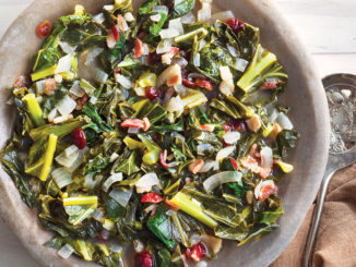 Vertical view of a bowl of warm collard and black-eyed pea salad