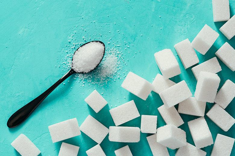 white sugar cubes on turquoise background